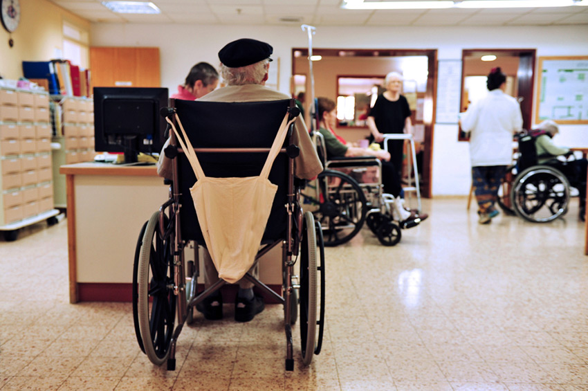 Nursing home scene with a senior in a wheelchair